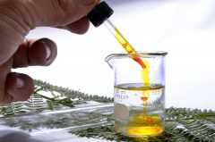 Droplets of oil inside a laboratory beaker