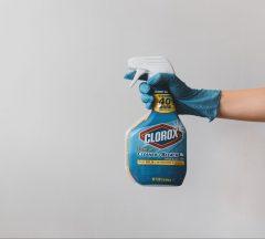 Man spraying Clorox bottle